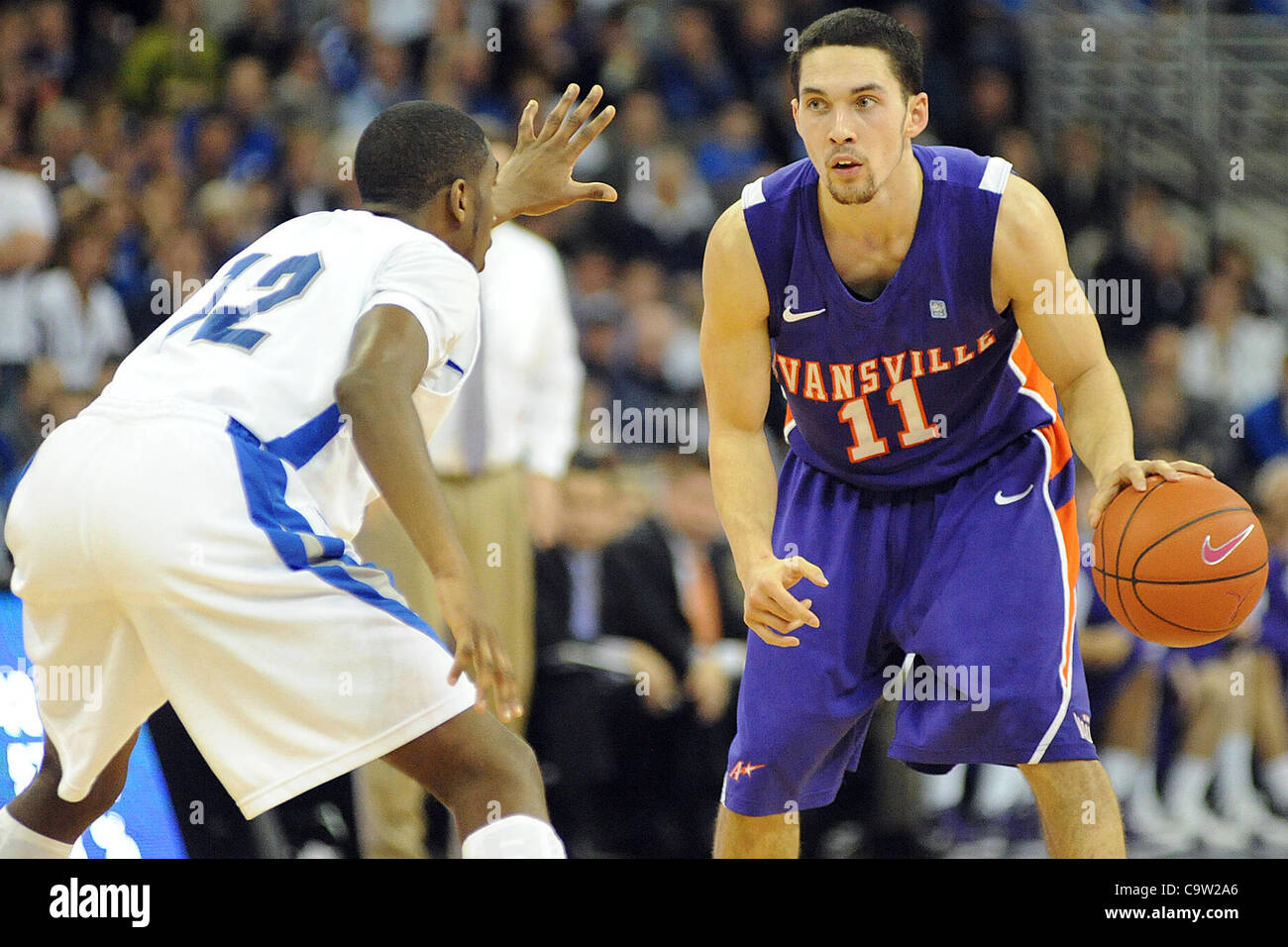 Feb. 21, 2012 - Omaha, Nebraska, U.S - Creighton guard Jahenns Manigat (12) could not stop Evansville guard Colt - Stock Image