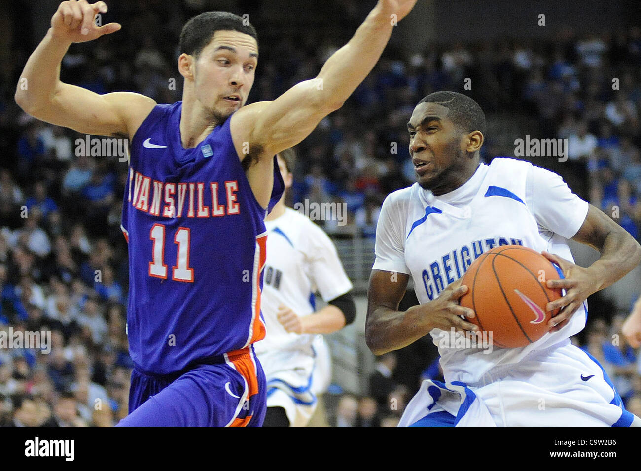 Feb. 21, 2012 - Omaha, Nebraska, U.S - Creighton guard Jahenns Manigat (12) drives around Evansville guard Colt - Stock Image