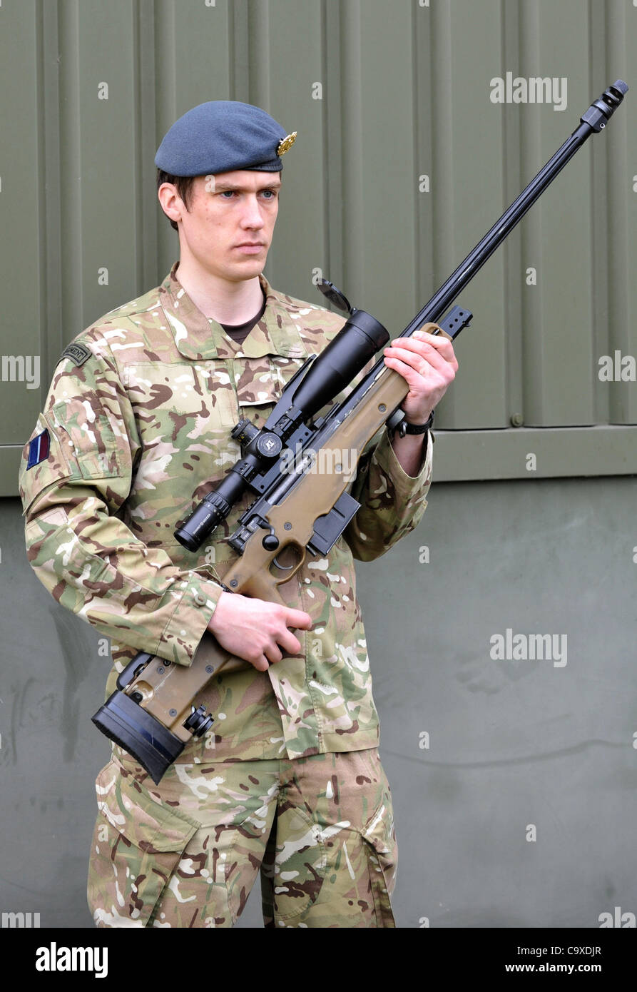 L96 sniper rifle, soldier with L96 sniper rifle - Stock Image