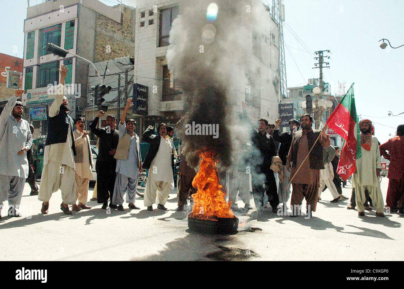 Supporters of Tehreek-e-Insaf (PTI) Youth Wing stand at