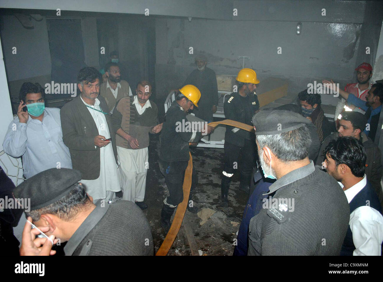 People gather after gas cylinder blast at Pathology Department at Lady Reading hospital (LRH) in Peshawar on Friday, - Stock Image