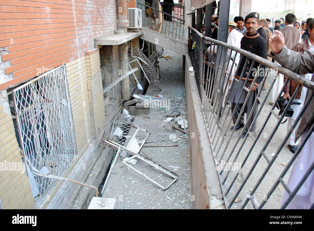 People gather at a damaged portion of building after gas cylinder blast at Pathology Department at Lady Reading - Stock Image