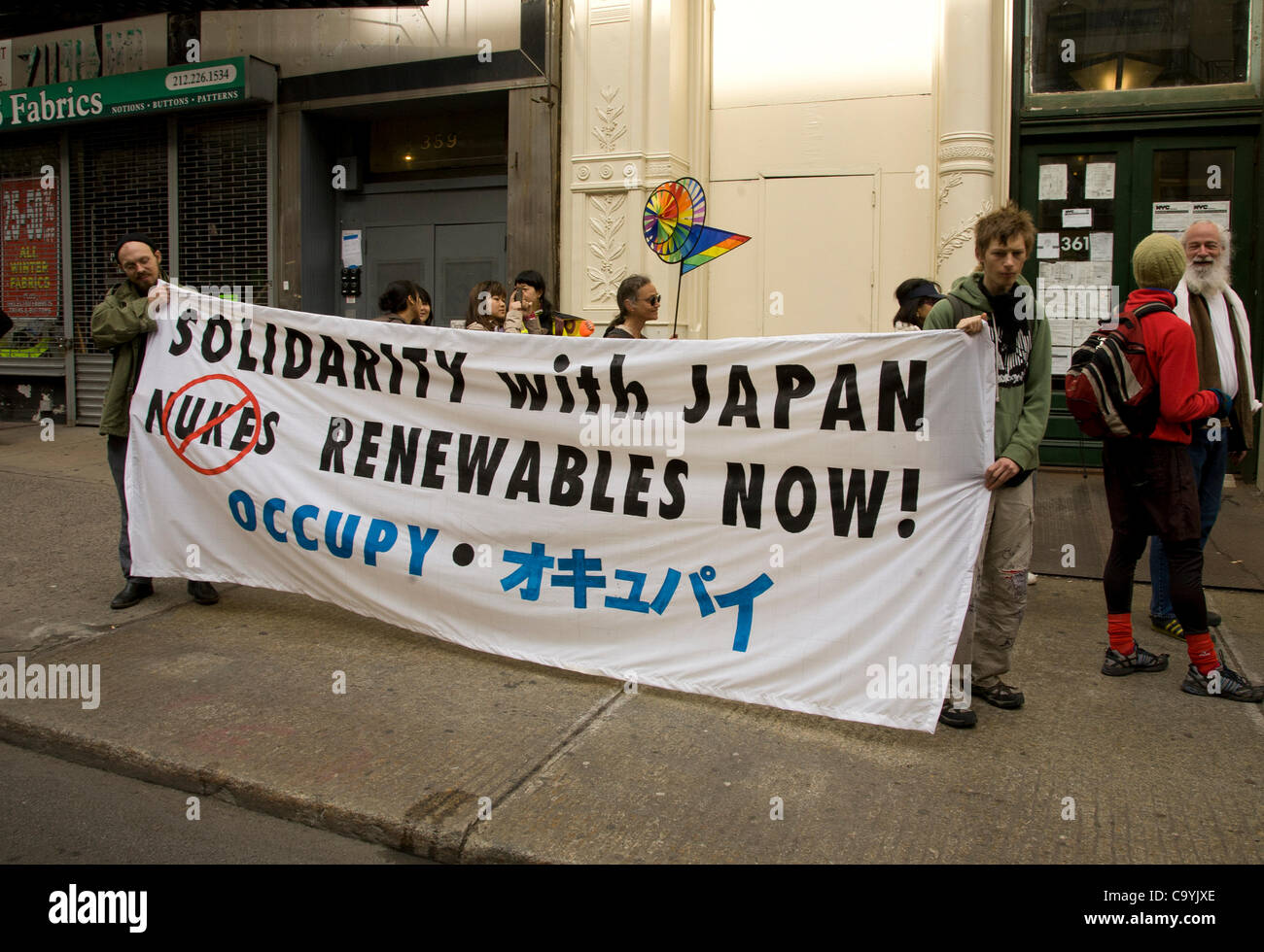 March 8, 2012: Buddhist and other Peace walkers who started at Oyster Creek nuclear plant in New Jersey go up Broadway - Stock Image