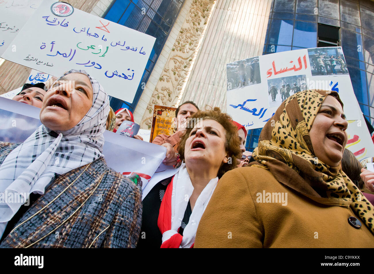 Egyptian women march on women's day to Parliament demanding a bigger representation in government  and the end - Stock Image