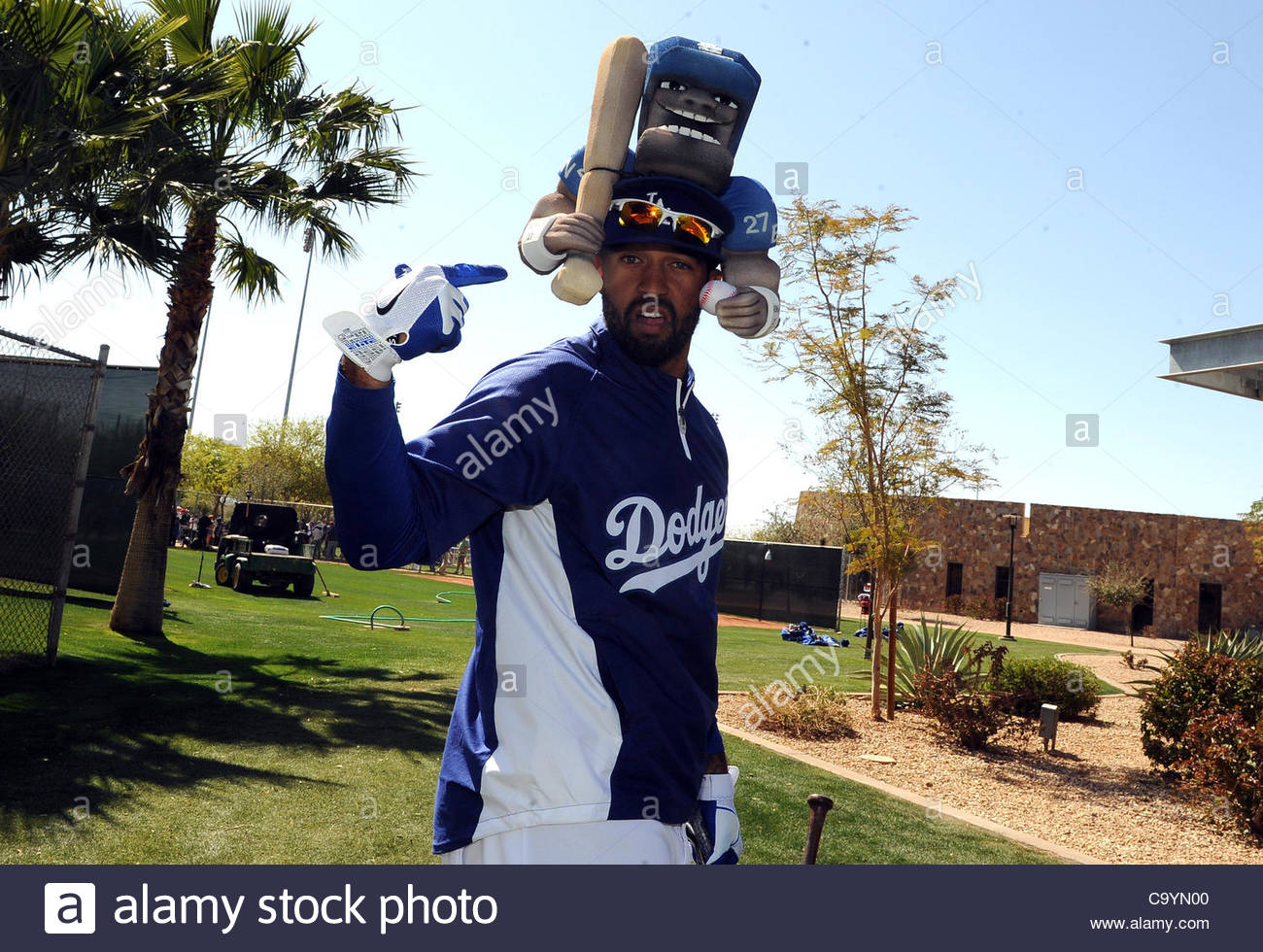5f4a28fa3d12d Los Angeles Dodgers  Matt Kemp wears a hat a fan gave him before a spring