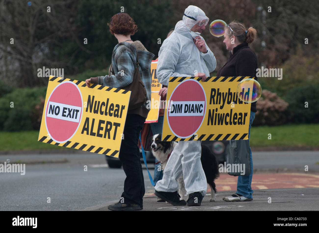 People against the proposed Wylfa B nuclear plant protest by the Menai Suspension Bridge Anglesey on March 11th - Stock Image