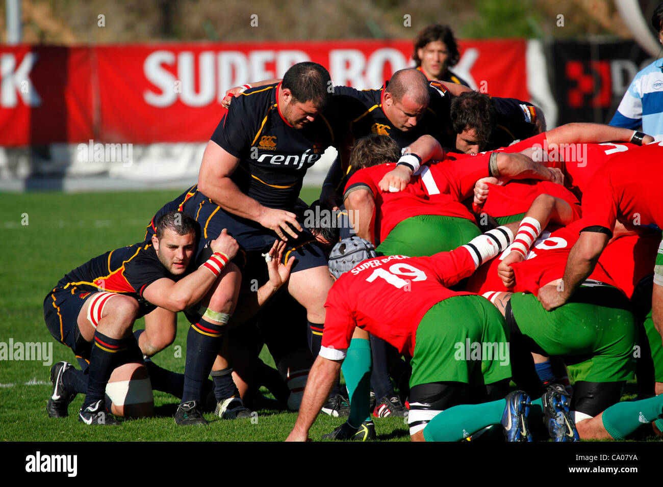Portugal (in red) scrum down against Spain (in blue) in an international rugby match. Portugal beat Spain 23 - 17 - Stock Image