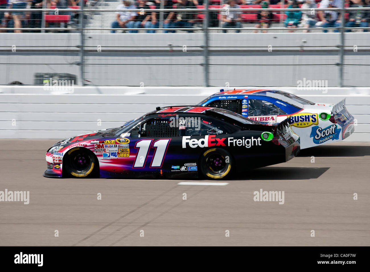 March 11, 2012 - Las Vegas, Nevada, U.S - Denny Hamlin, driver of the #11 FedEx Freight Toyota Camry, battles to - Stock Image
