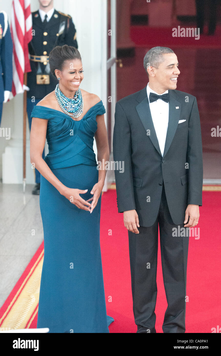 President Barack Obama and First Lady Michelle greet Prime Minister David Cameron and Samantha Cameron before a - Stock Image