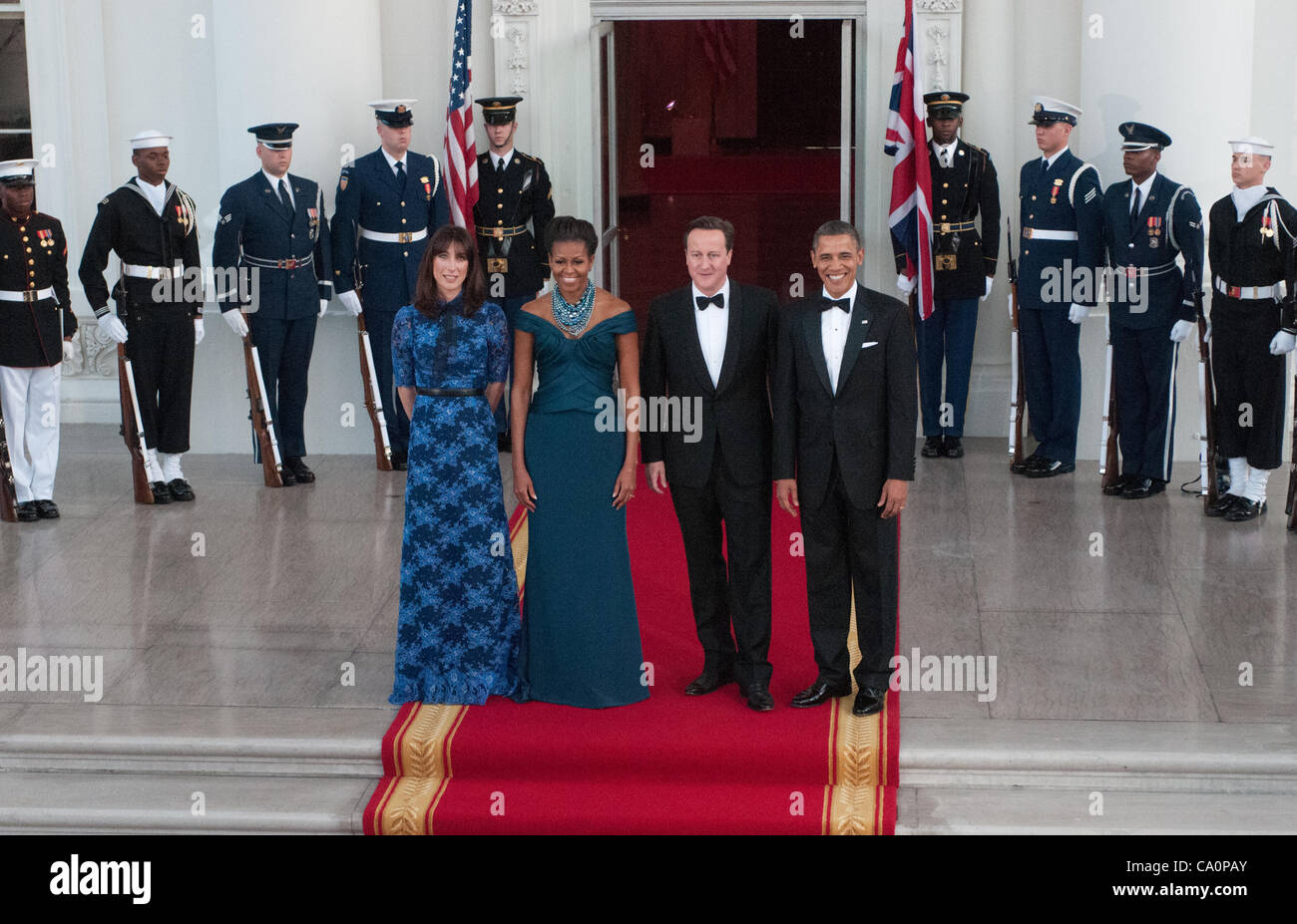 President Barack Obama and First Lady Michelle greet Prime Minister David Cameron and wife Samantha before a black - Stock Image