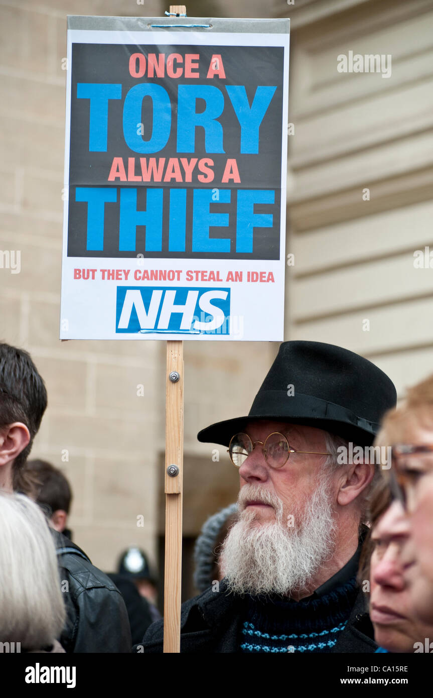 Man carries a placard with Once a Tory always a Thief at the NHS protest in front of Department of Health, Richmond - Stock Image