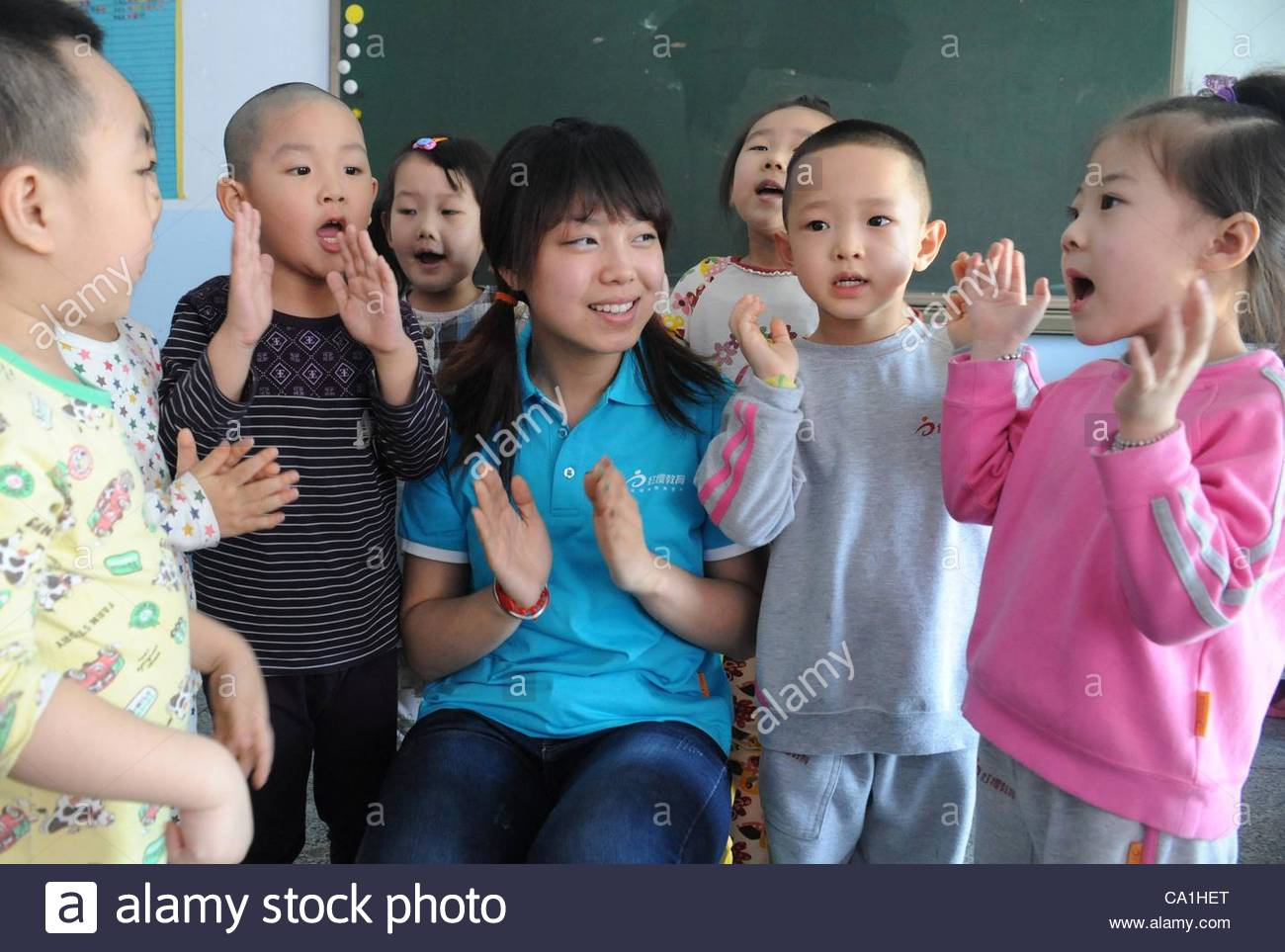 A nursery rhyme singing activity is holding in a kindergarten to celebrate the coming International Children's - Stock Image