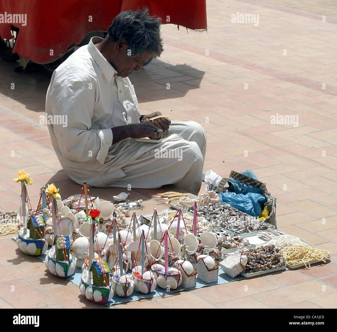 A Man Sells Handmade Home Decoration Items To Earn His Livelihood For  Support His Family At Seaview Beach In Karachi On Tuesday, March 20, 2012.