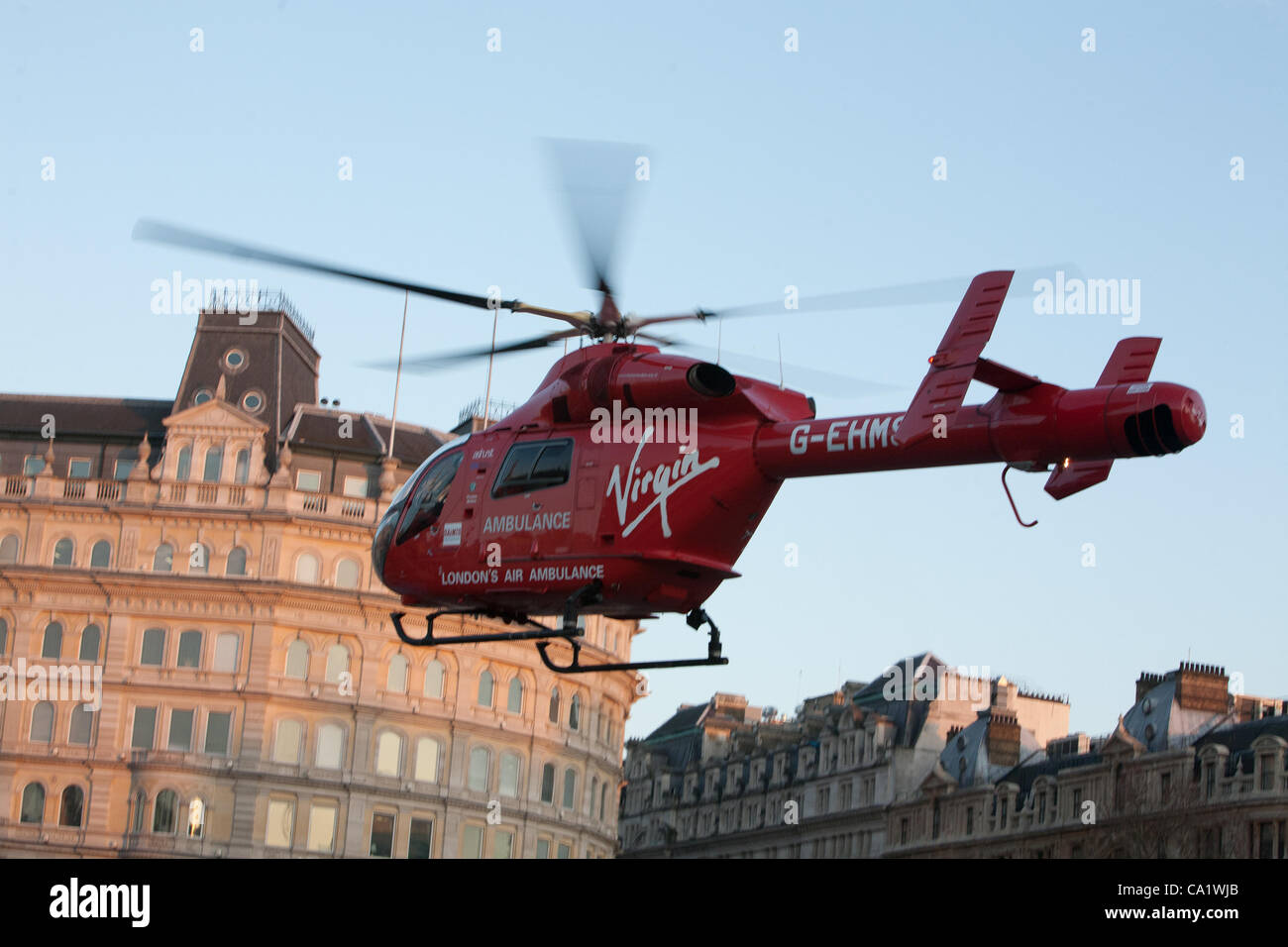 London, UK, 21/03/2012, Air ambulance landed in Trafalgar Square in rush hour, reportedly to help with a casualty - Stock Image