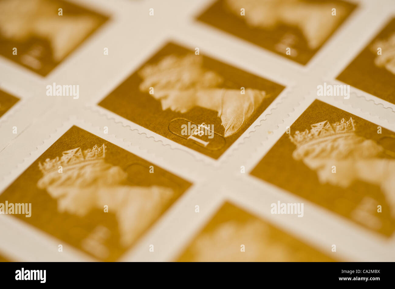 A sheet of first-class postage stamps. They will rise 30%  in price from 46p to 60p from 30 April 2012 after the Stock Photo