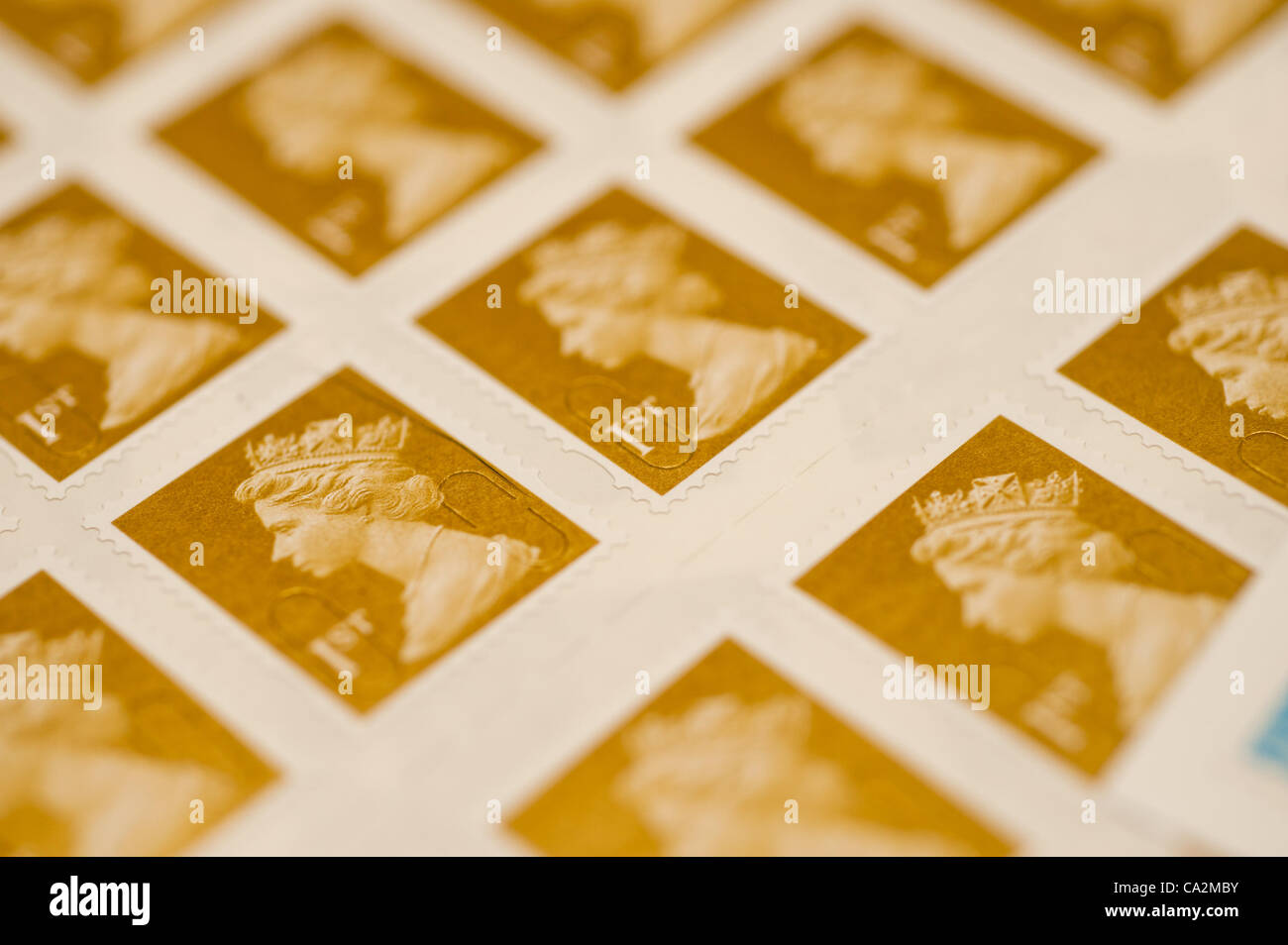 A sheet of first-class postage stamps. They will rise 30%  in price from 46p to 60p from 30 April 2012 after the - Stock Image