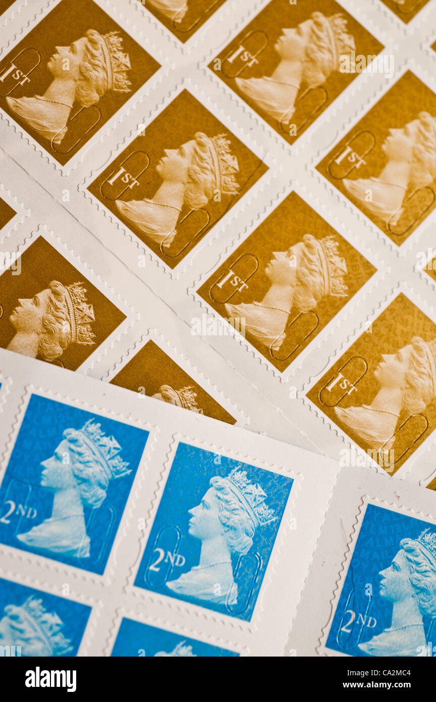 A first-class postage stamp will rise 30%  in price from 46p to 60p from 30 April 2012 after the UK regulator eased - Stock Image