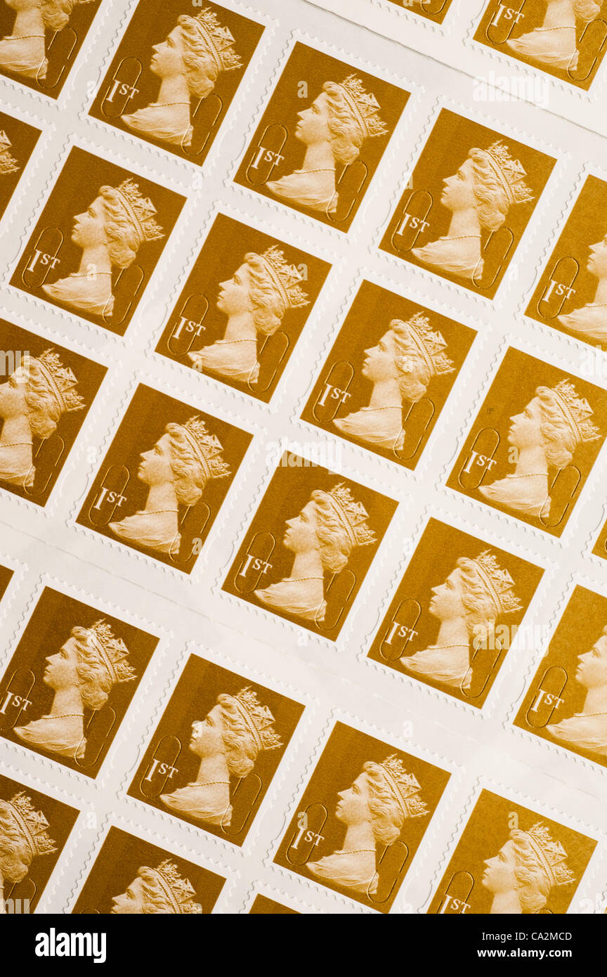 A sheet of first-class postage stamp.They will rise 30%  in price from 46p to 60p from 30 April 2012 after the UK - Stock Image