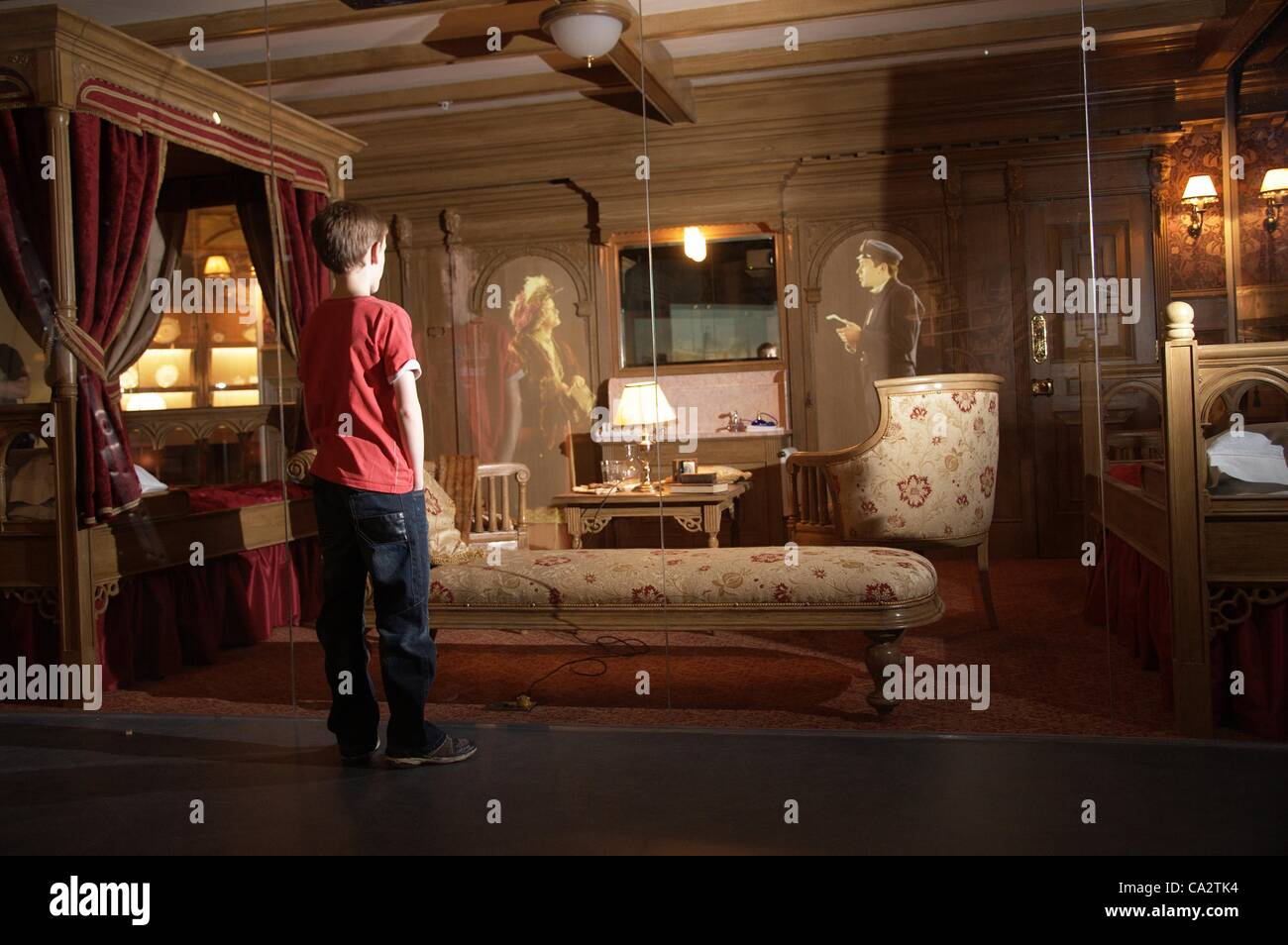 Young Boy Views A Recreation Of A First Class Cabin On The Titanic In The  Titanic