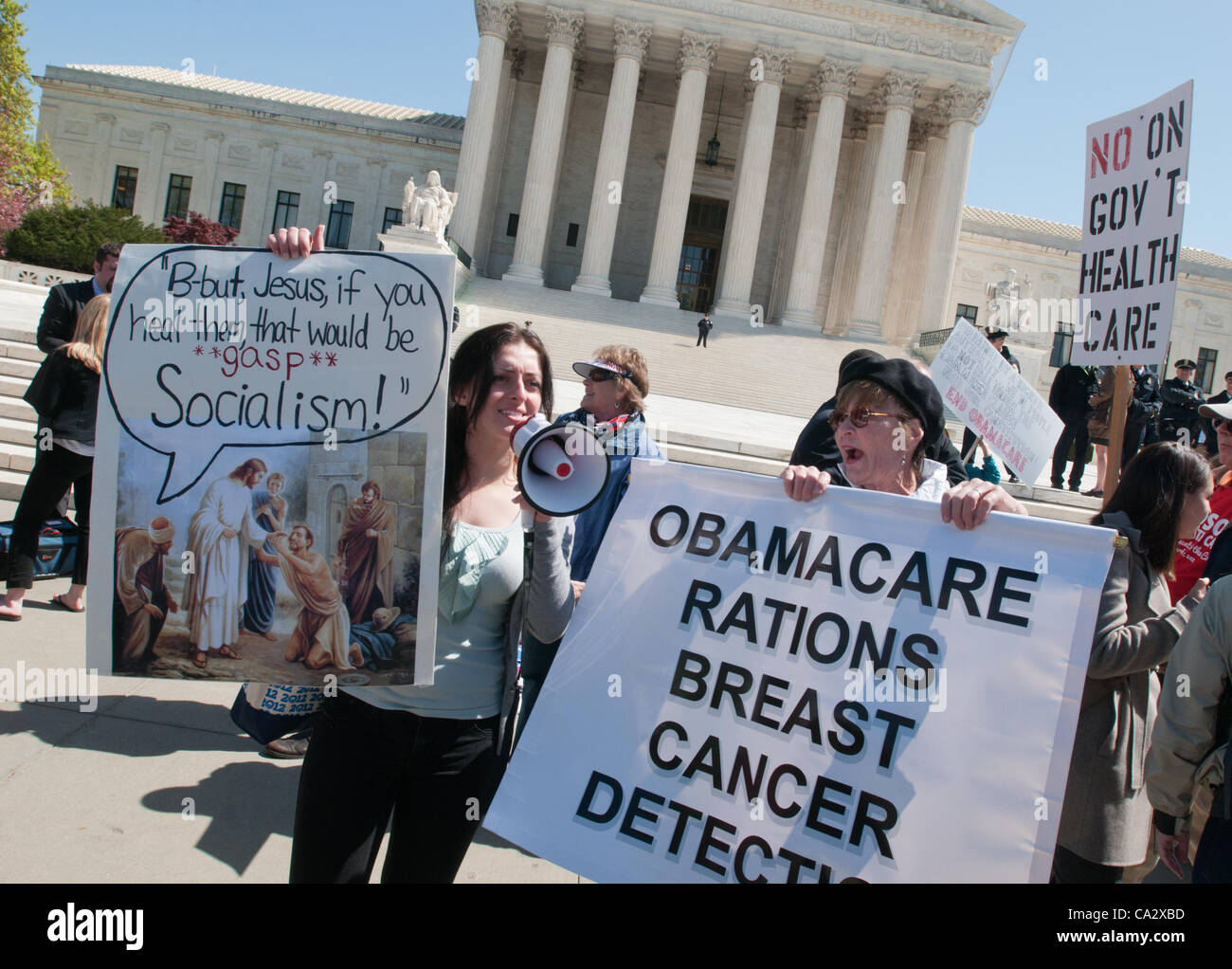 Healthcare bill protesters shout during the second day of Supreme Court debating the constitutionality of Barack - Stock Image