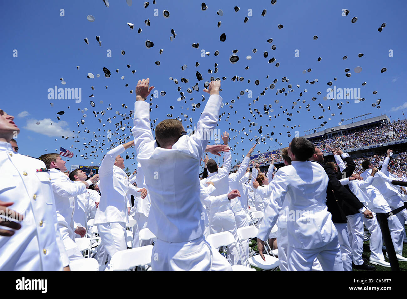 Sailors toss their hats in the air to mark the official closing of the 2012 US Naval Academy graduation and commissioning Stock Photo
