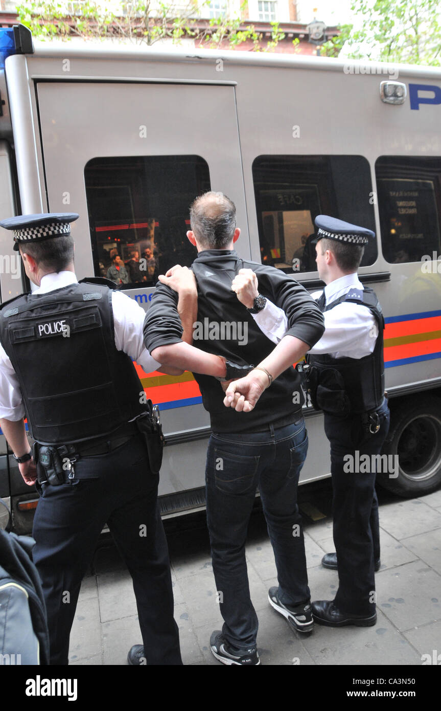 2nd June 2012. Leicester Square, London, UK. A Belgian football fan is arrested outside Leicester Square Tube station - Stock Image