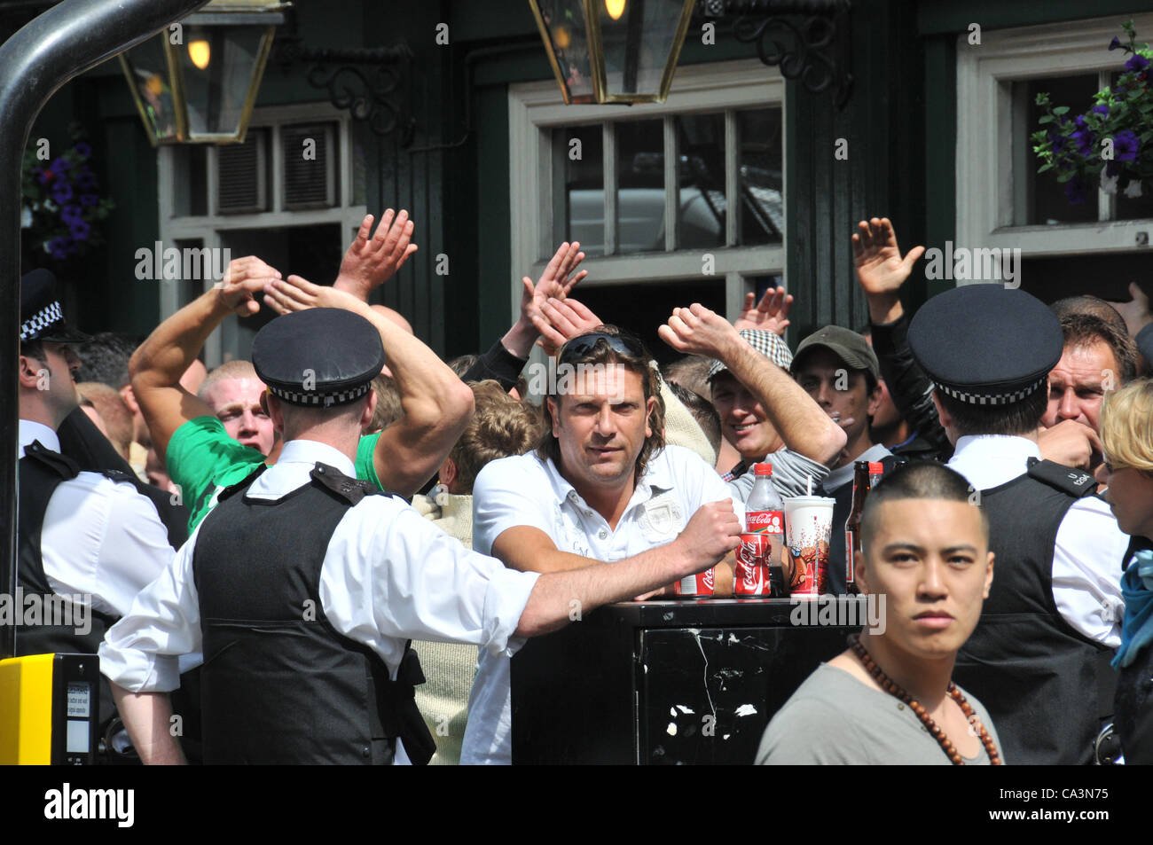 2nd June 2012. Leicester Square, London, UK. Tension mounts as Police seperate football fans outside Leicester Square - Stock Image