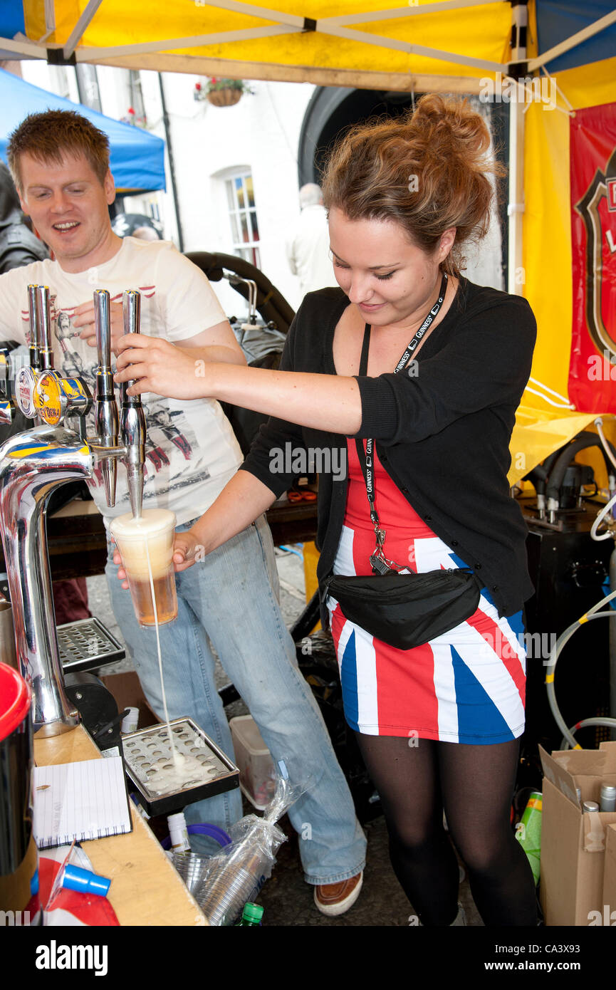 Winchester Diamond Jubilee street party Hampshire UK 03June 2012 Young attractive barmaid wearing a Union Jack style - Stock Image