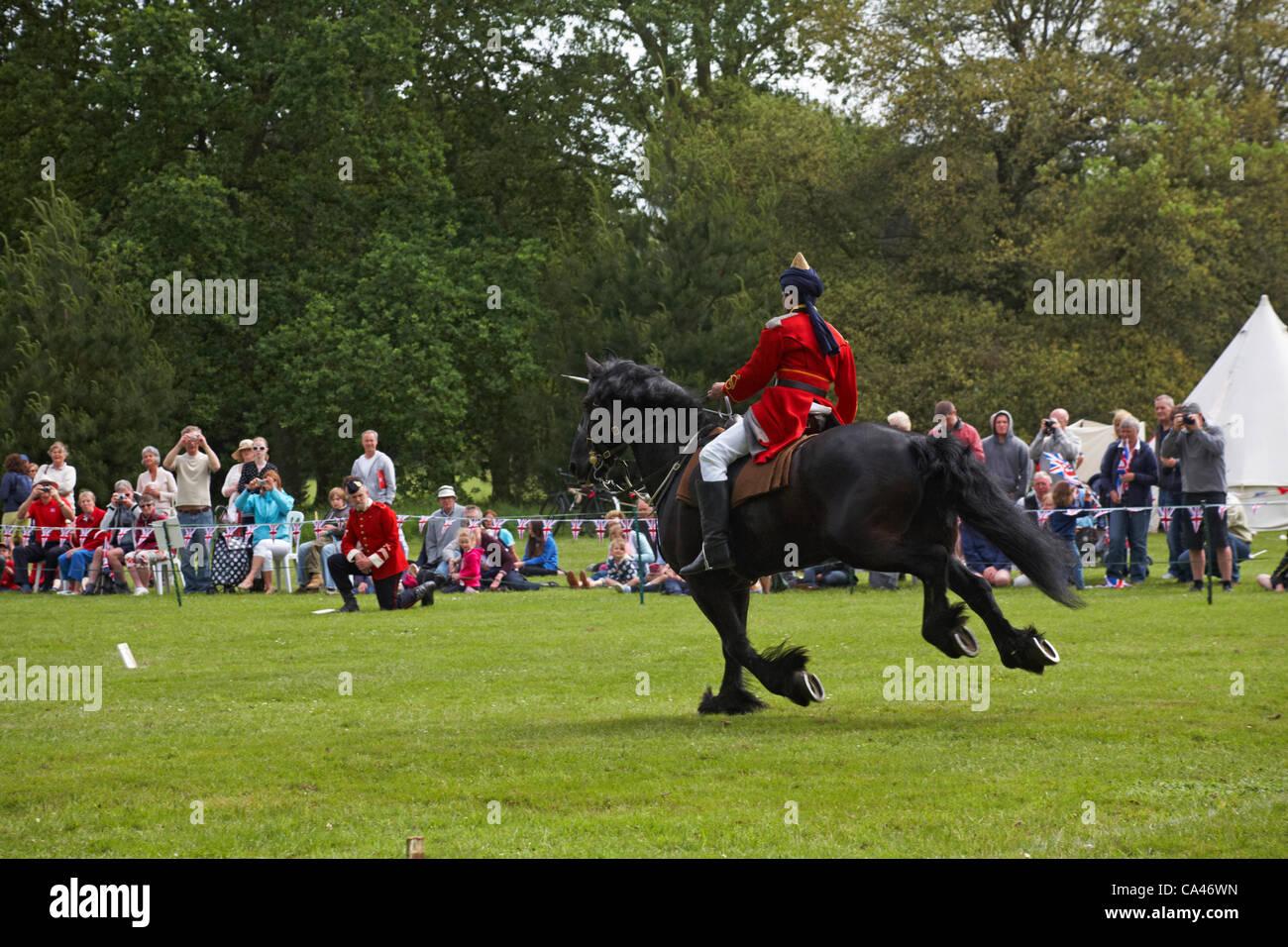 Isle of Wight, UK Sunday 3 June 2012. Jubilee celebrations at Osborne House. Prince Maliks Lancers leader the charge. - Stock Image