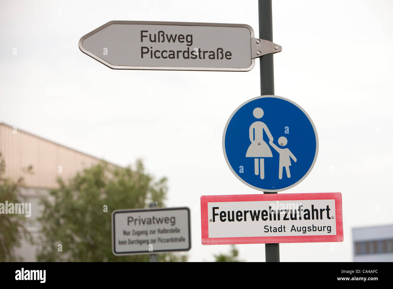 pedestrian, posters, signage, description, urban, city, Munich, Germany, road, sing, family, street - Stock Image