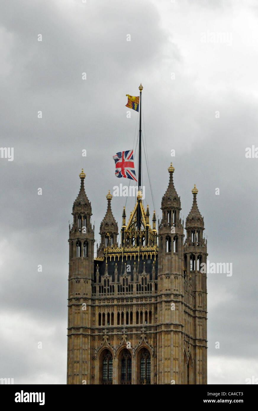 Queens Diamond Jubilee the Union Jack is lowered as the Sovereign's ensign is raised at Westminster hall as - Stock Image