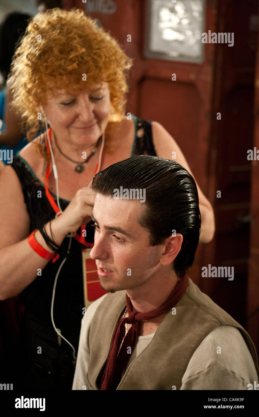 An Israeli Opera Carmen performer's hair is done, backstage, before full dress rehearsal. Massada, Israel. 6-June - Stock Image