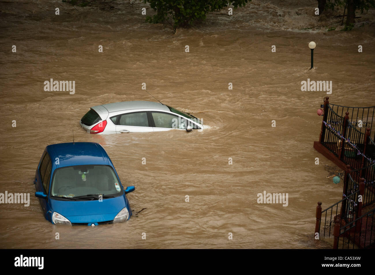 Ceredigion, Wales, UK. Saturday June 9 2012. Caravans and cars submerged by the waters of the River Leri at the Stock Photo