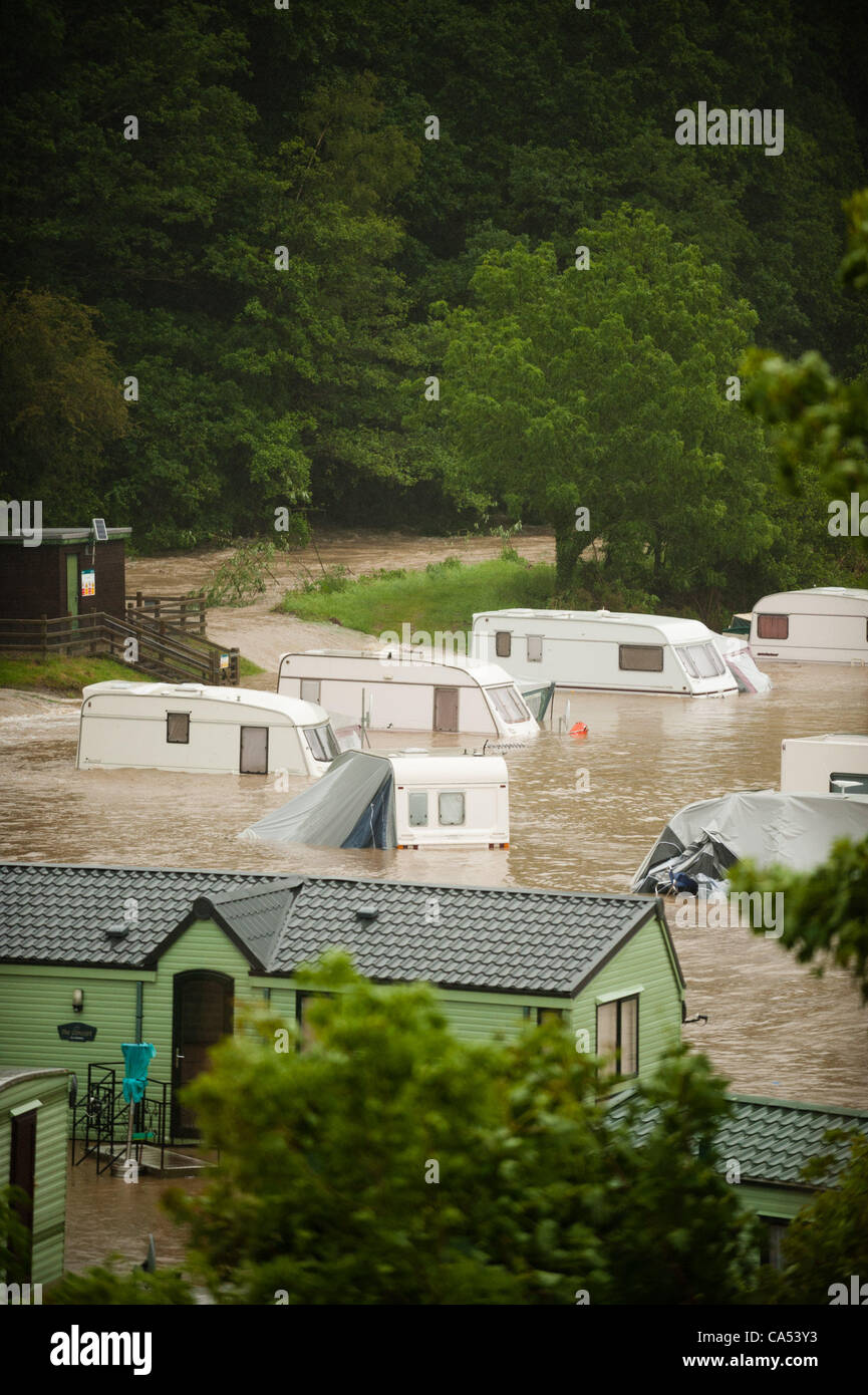 Ceredigion, Wales, UK. Saturday June 9 2012. Caravans and cars submerged by the waters of the River Leri at the - Stock Image