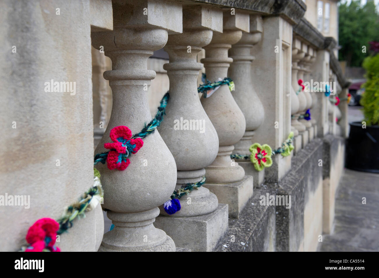 June 9th 2012. International Yarn Bombing Day. Decorative flowers left on the pillars at the front of the Town Hall Stock Photo