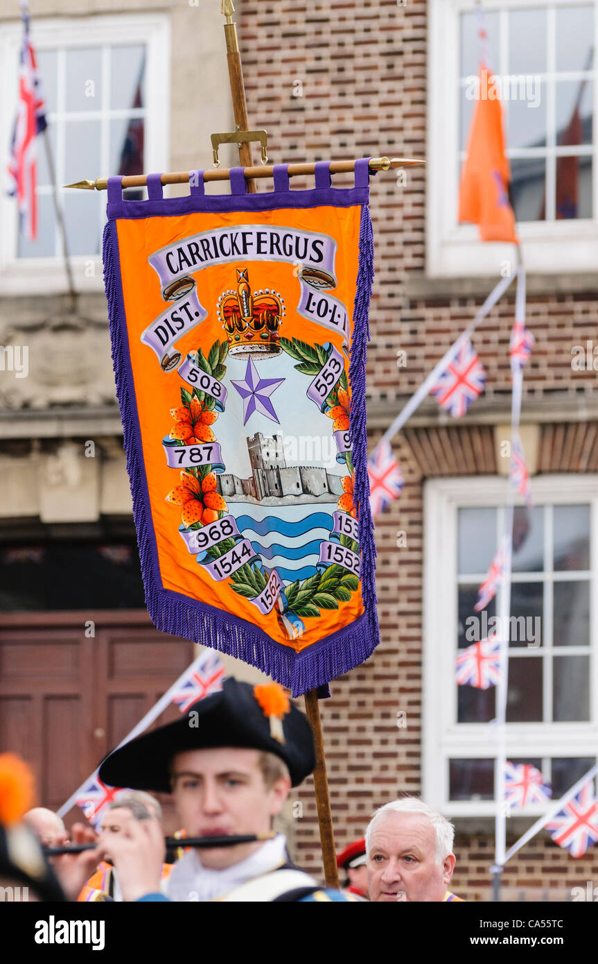 Loyal Orange Order banner being carried in front of the Orange Hall - Stock Image