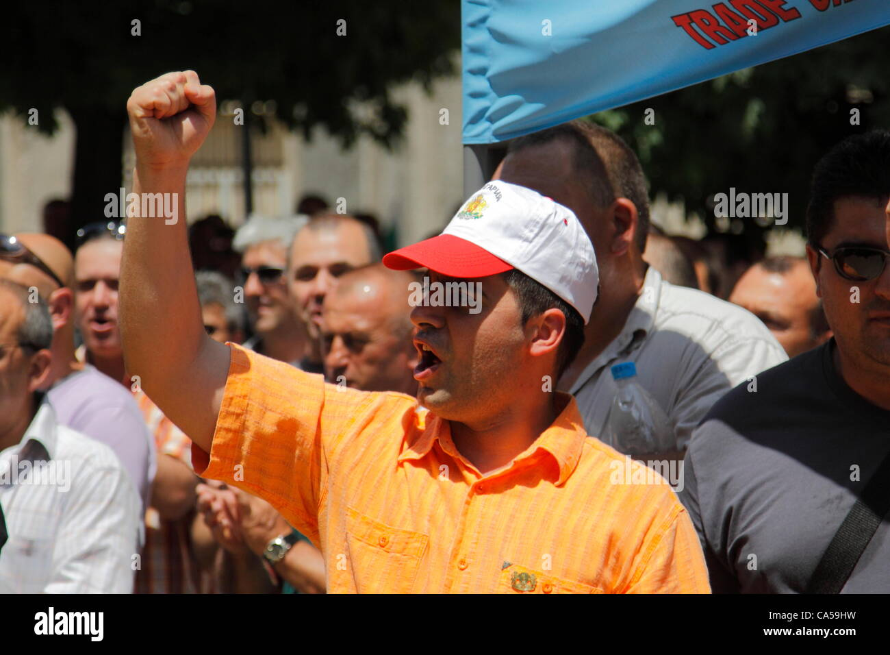 Angry demonstrator shaking his fist and shouting slogans during the rally of Bulgarian prison guards in Sofia. Employees - Stock Image