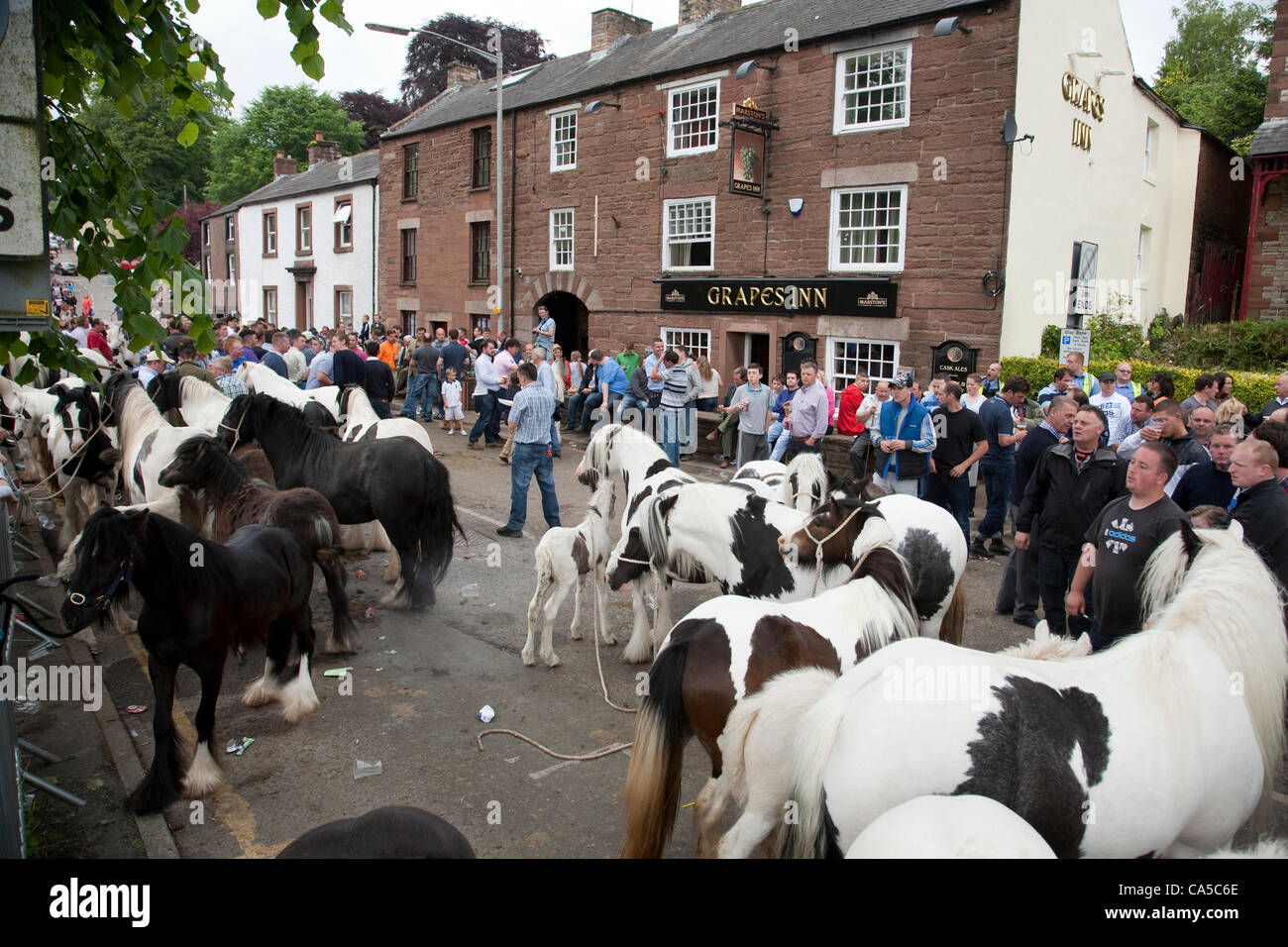 Sunday 10th June 2012 at Appleby, Cumbria, England, UK. Horse traders and visitors fill The Sands (street name) - Stock Image