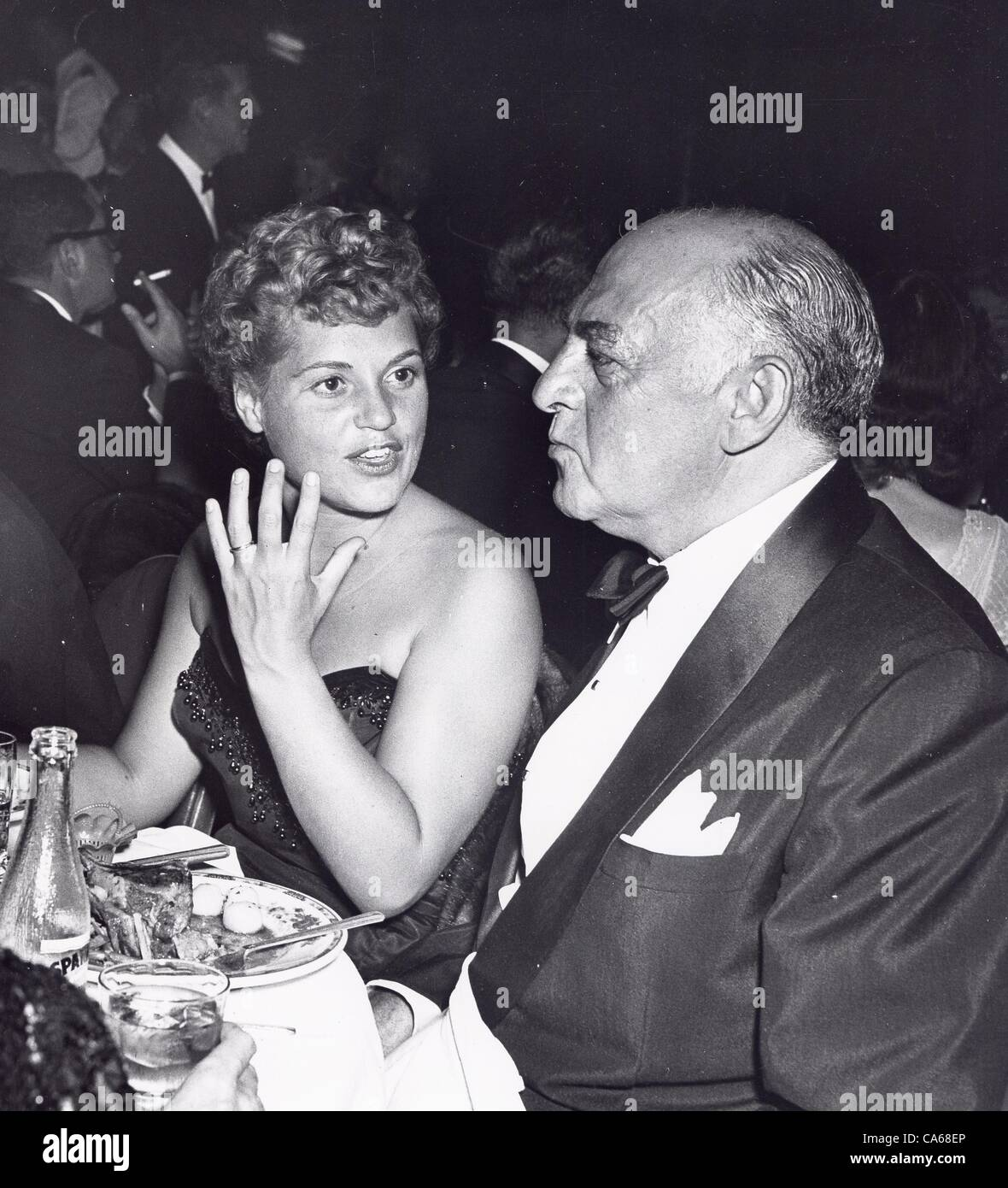 JUDY HOLLIDAY with Harry Cohn t the special dinner for Jesse Lasky , Ambassador Hotel.Supplied by   Photos inc.(Credit - Stock Image