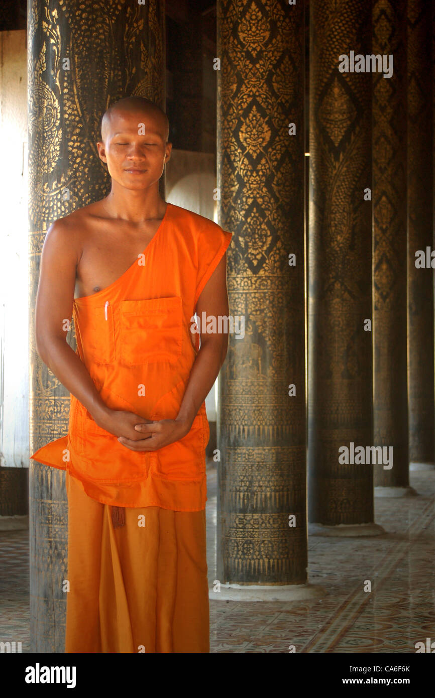 Young monk meditating up - Stock Image