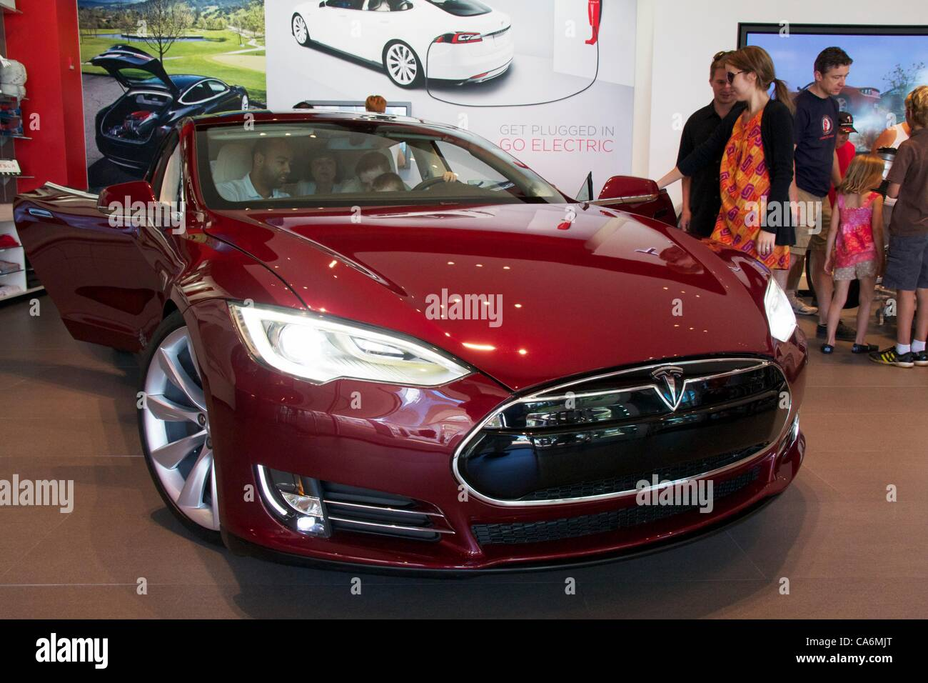17, June, 2012, Oak Brook, Illinois, USA. Prospective customers consider the new Tesla Motors Model S. The Model - Stock Image