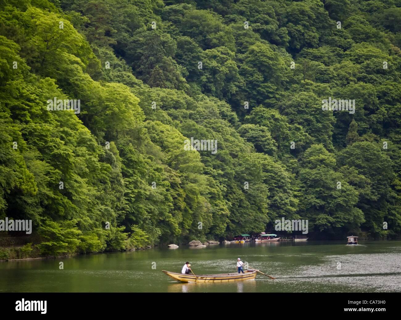June 13, 2012 - Kyoto, Japan - June 13, 2012 - Kyoto, Japan - Boatmen on the Hozu river near Arashiyama Monkey Park - Stock Image