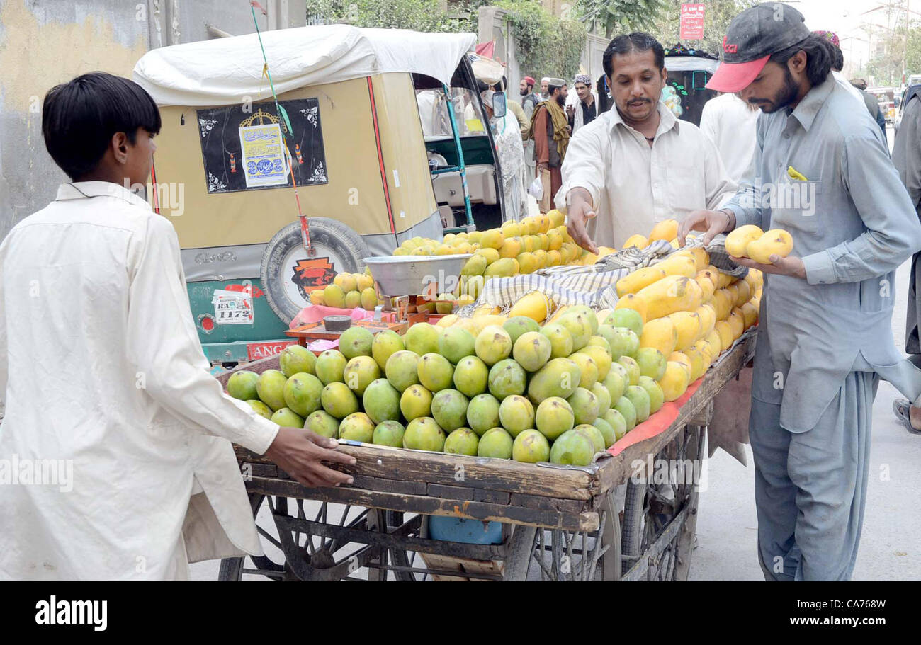9eadf27800f People busy to buy mango at push-carts in Quetta on Wednesday
