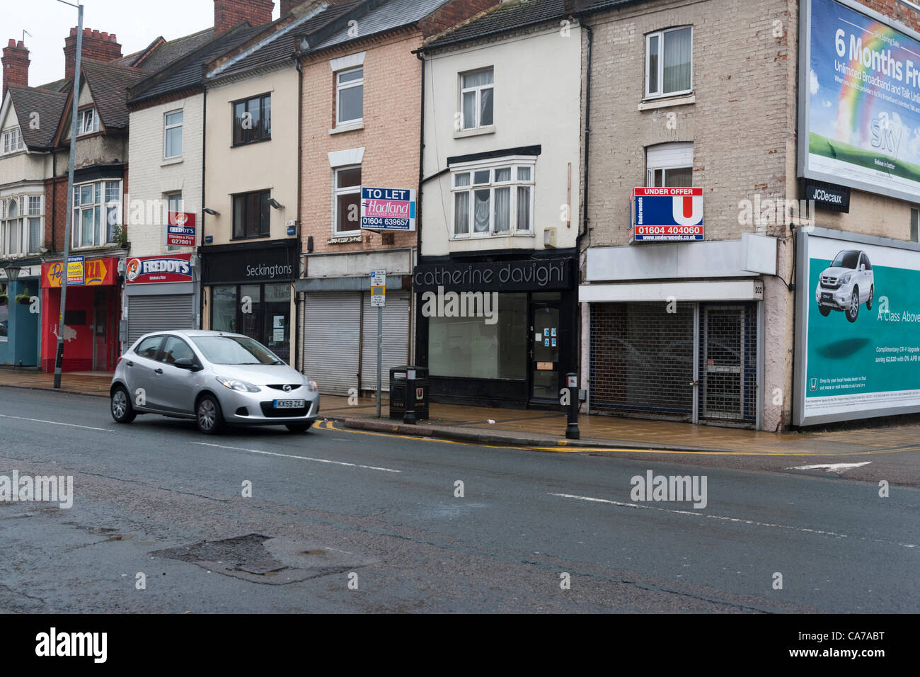 21st May 2012.  Wellingborough Rd. Northampton. England, UK. Shops showing signs of the recession biting, empty - Stock Image