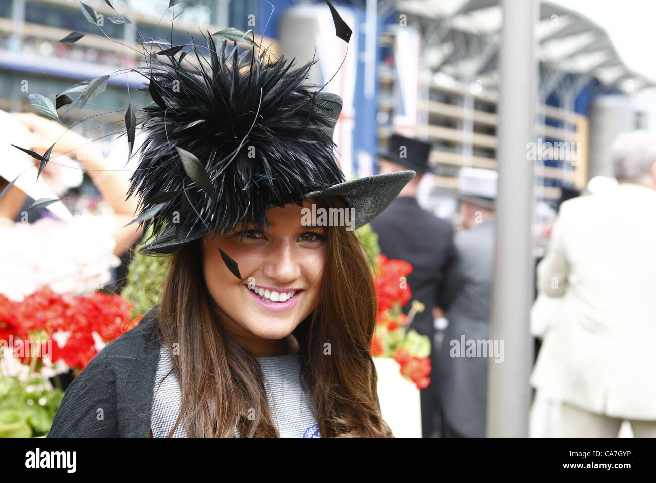 22.06.12 Ascot, Windsor, ENGLAND: Racegoes coping with wind before the fourth day at Ascot during Royal Ascot Festival - Stock Image