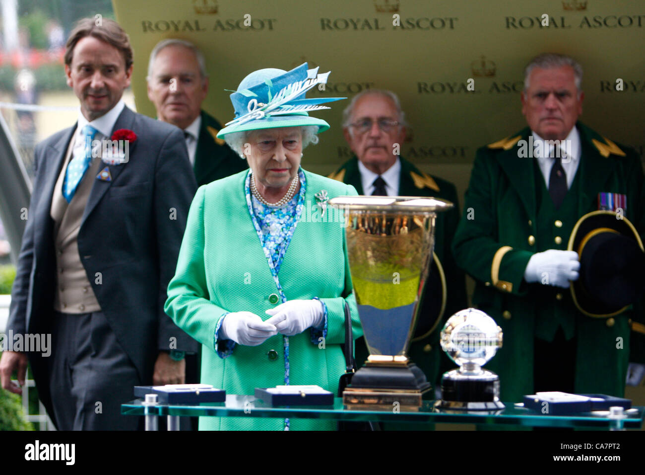 23.06.2012 Ascot, Windsor, ENGLAND, UK:  Queen Elizabeth II presents one of the Owners of Black Caviar with the - Stock Image