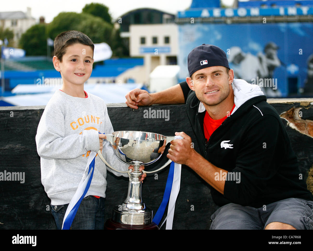 23.06.12 Devonshire Park, Eastbourne, ENGLAND: Andy Roddick (USA) with his ATP Tour title trophy at the AEGON INTERNATIONAL - Stock Image