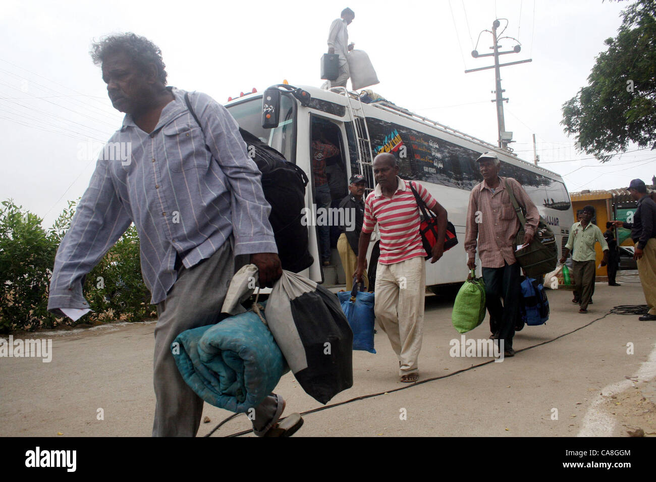 Freed Indian fishermen, who were imprisoned for violating  territorial waters, come out from Malir prison after Stock Photo