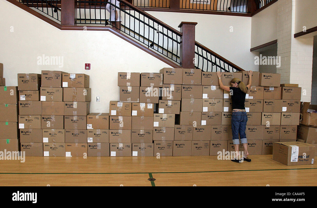 Beth Nelson of Rancho Santa Fe, pulls down on costume boxes