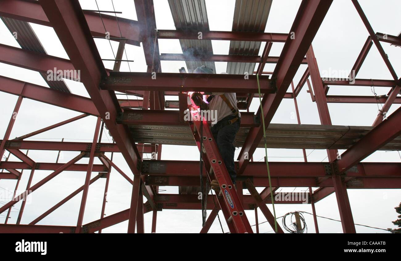 (Published 2/21/2005, B-1) A welder using a torch fuses girders next to each other at Fire Station 31 in Del Cerro. - Stock Image